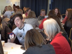 Young Carers talking to professionals at the conference